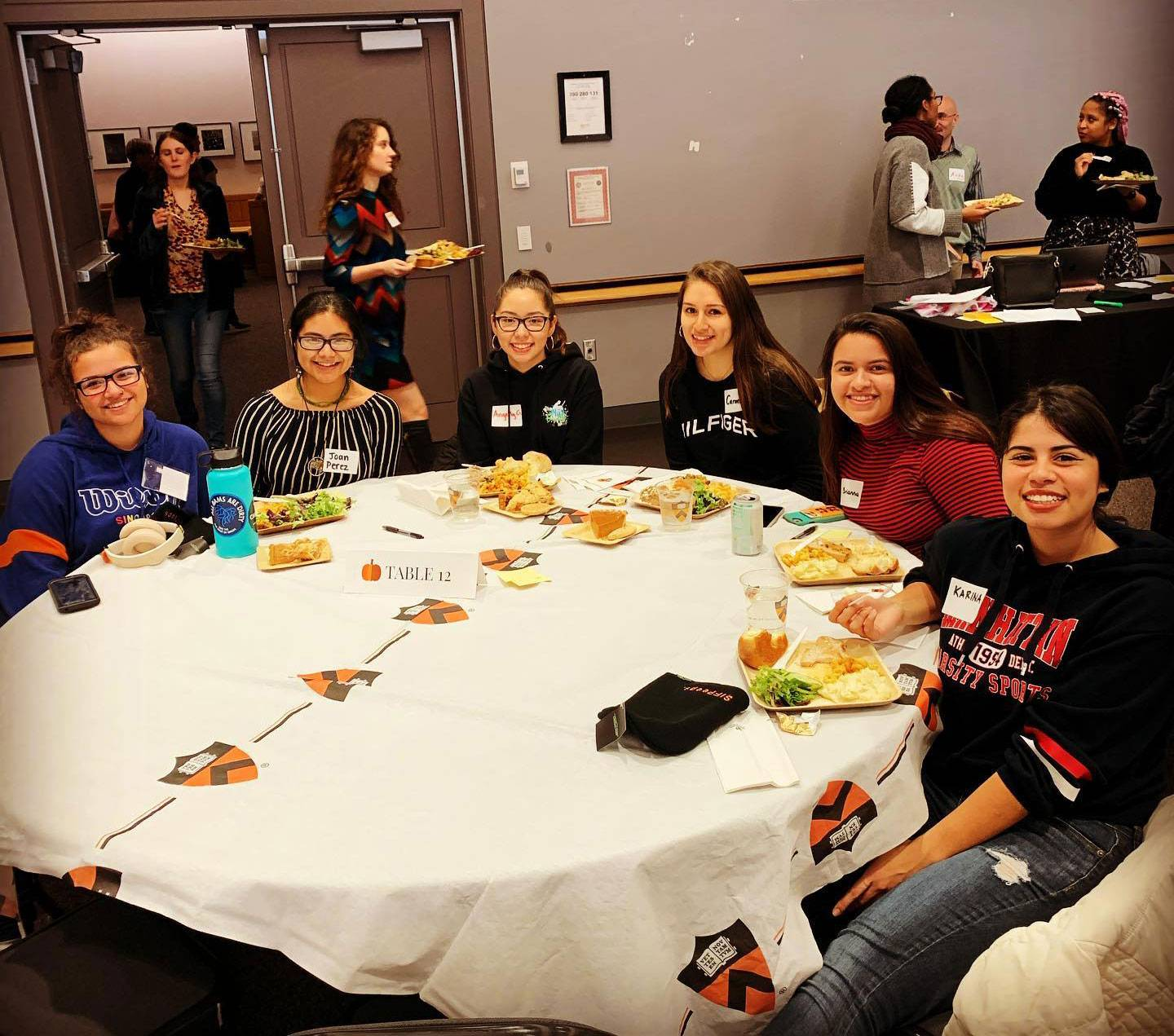 Students share a meal together at a table