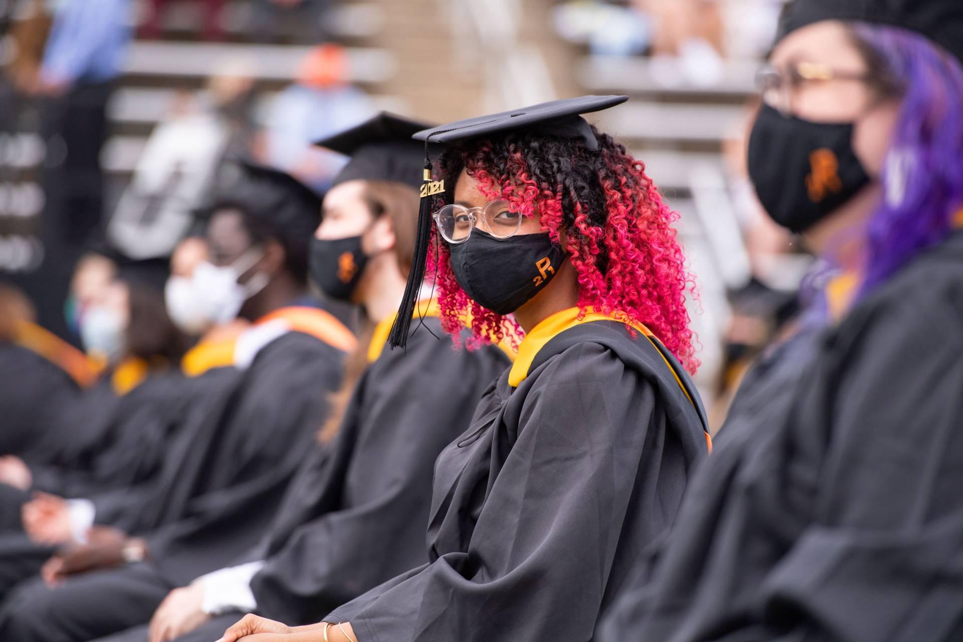 Undergraduates sit at their places in the stadium