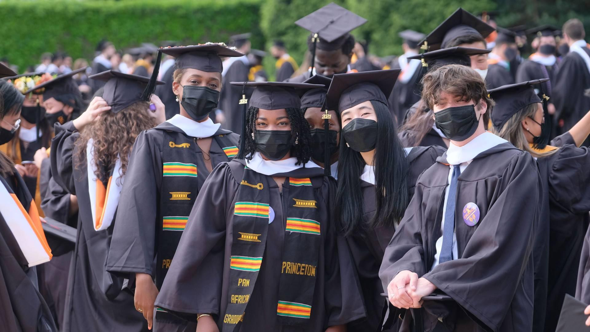 Graduating seniors in mortarboards and gowns