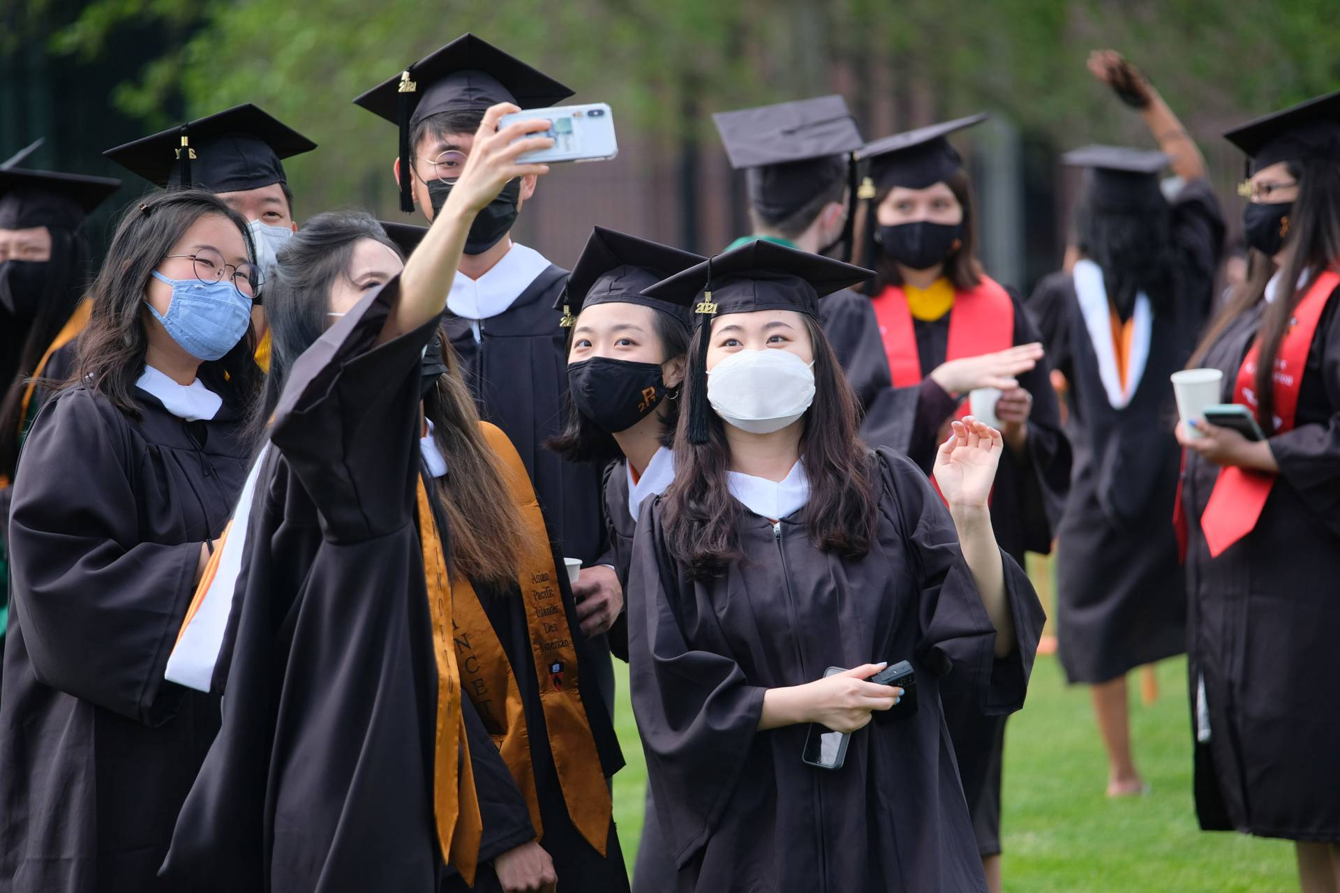 A group of graduating students pose