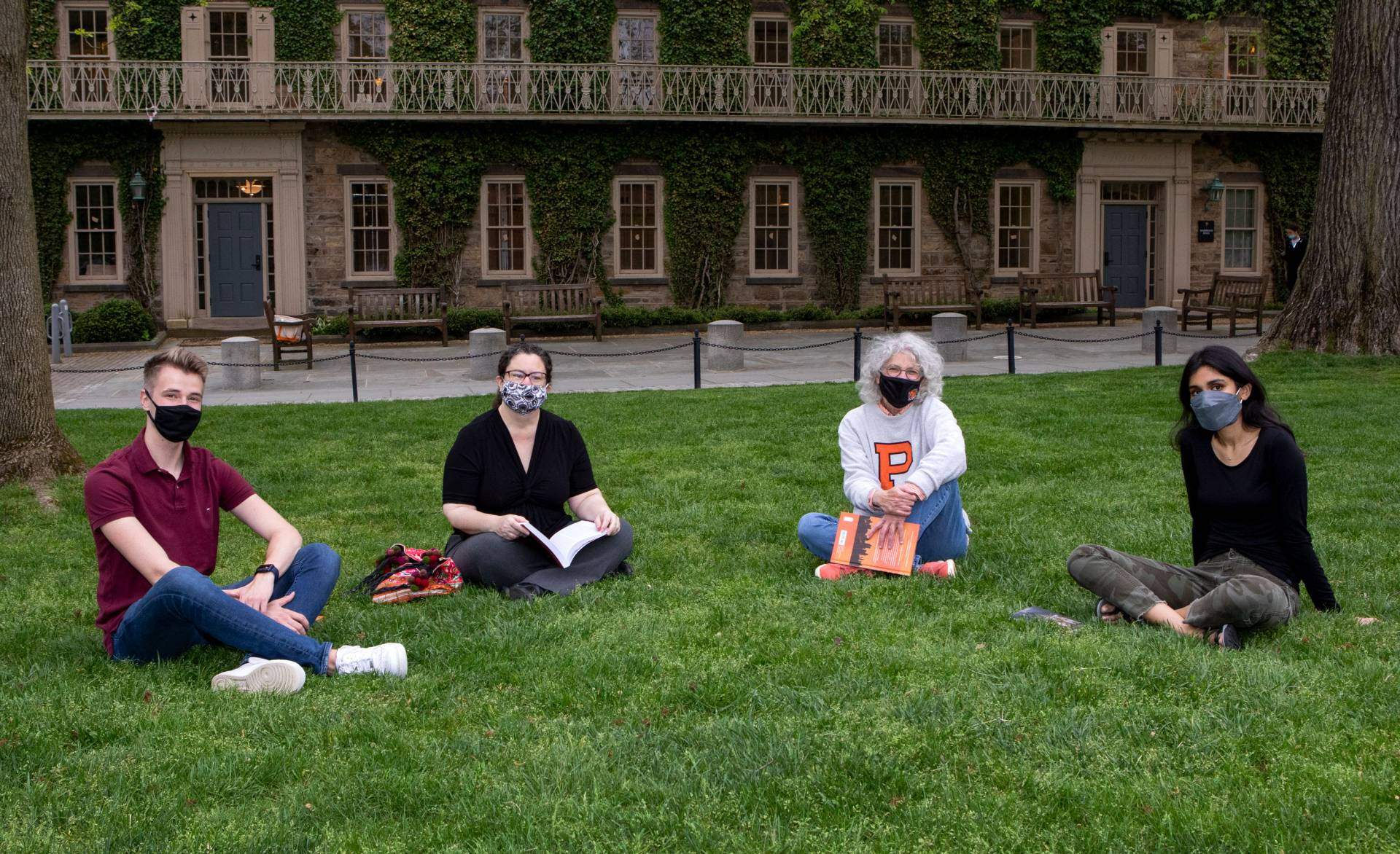Jill Dolan holds a precept on the lawn outside Morrison Hall with with Beth Stroud and 2 students