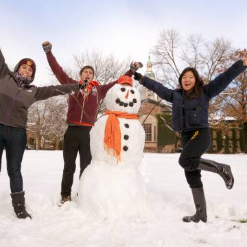 Students with snowman in winter