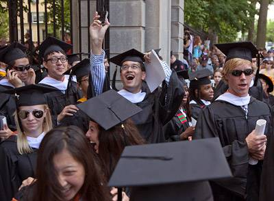 Graduates recessing through gate