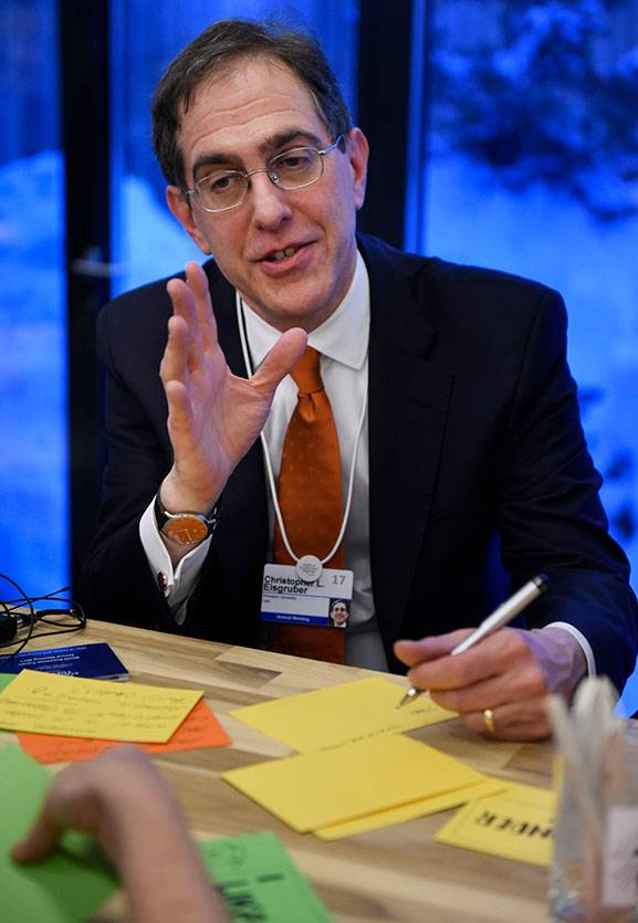 "Pen in hand, Princeton President Christopher L. Eisgruber makes a point Thursday, Jan. 19, during a Princeton University ""Ideas Lab"" program at the annual World Economic Forum in Davos, Switzerland."