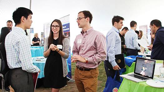 Students meet employer reps at a career fair