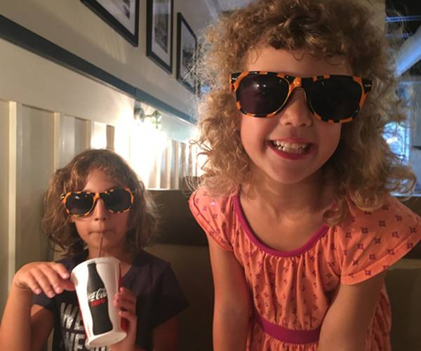 Children wearing tiger sunglasses