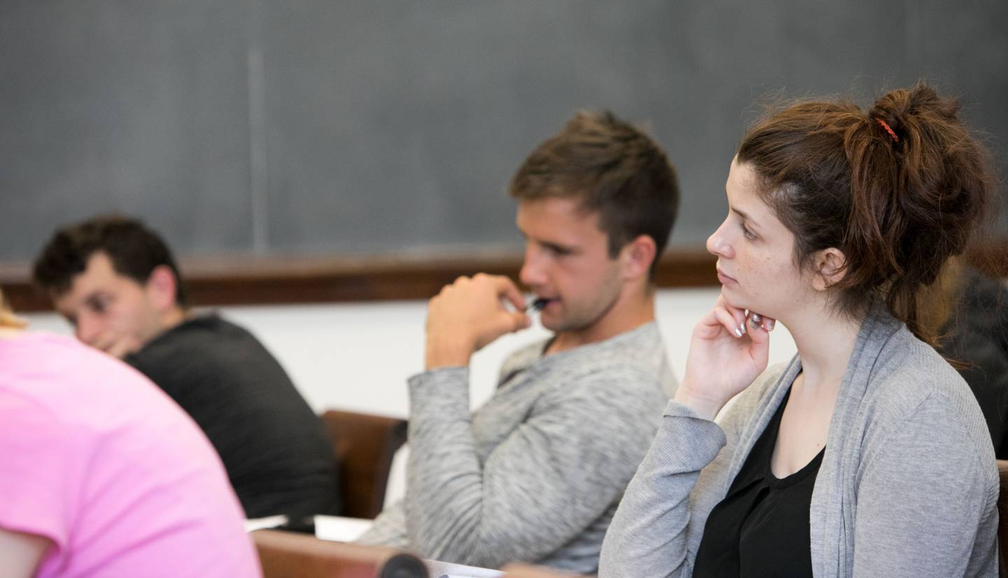 Students in classroom listening to professor
