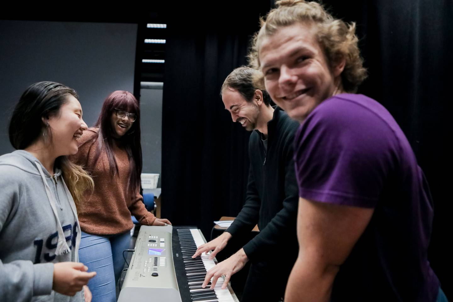 Students rehearsing at keyboard