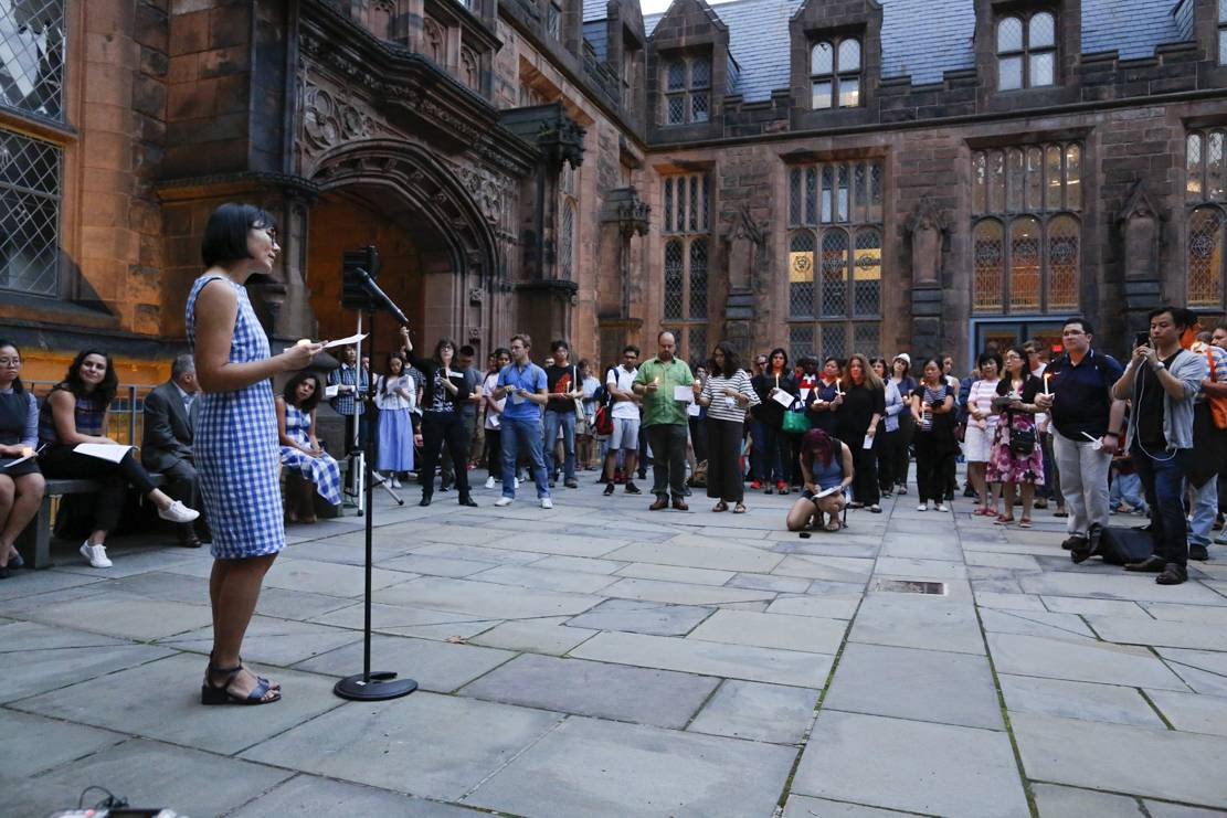 Hua Qu speaks at vigil on campus for her husband, Xiyue Wang.