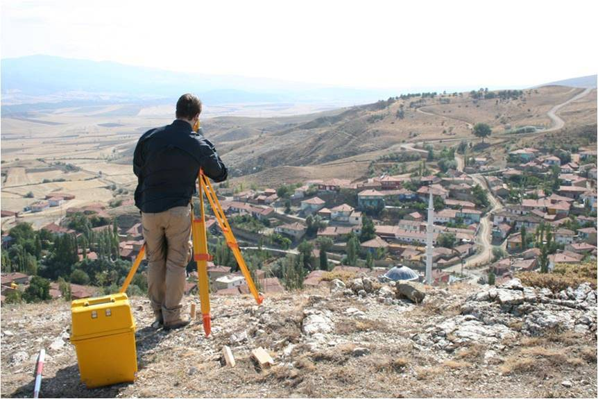 Setting up the total station on the edge of the Kale Tepes, Turkey