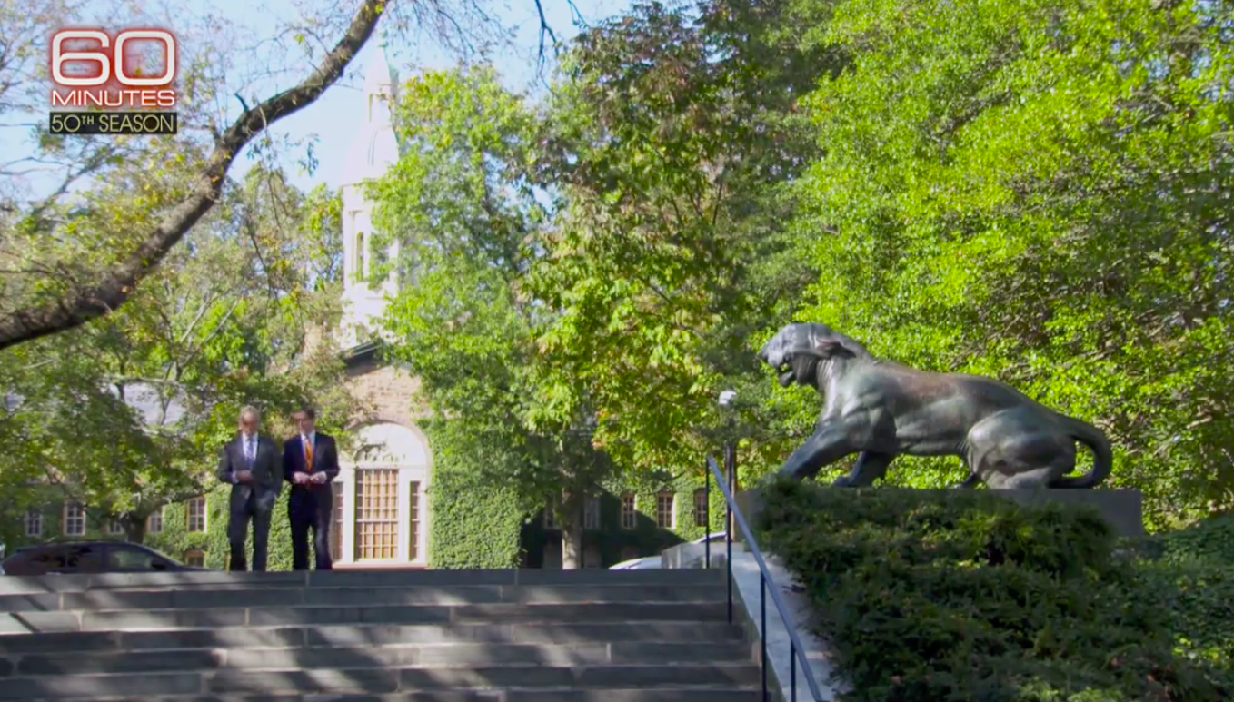 "President Eisgruber walks on campus with ""60 Minutes"" correspondent Scott Pelley."