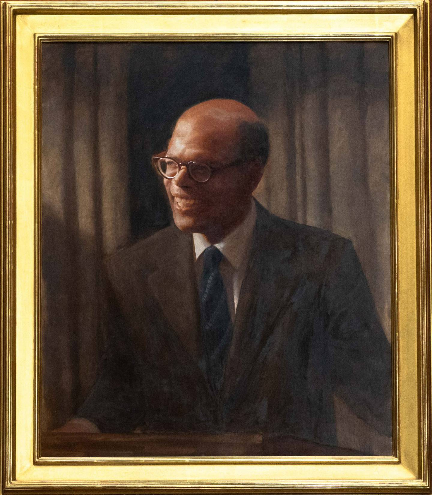 Framed portrait of Sir Arthur Lewis by Daniel Adel