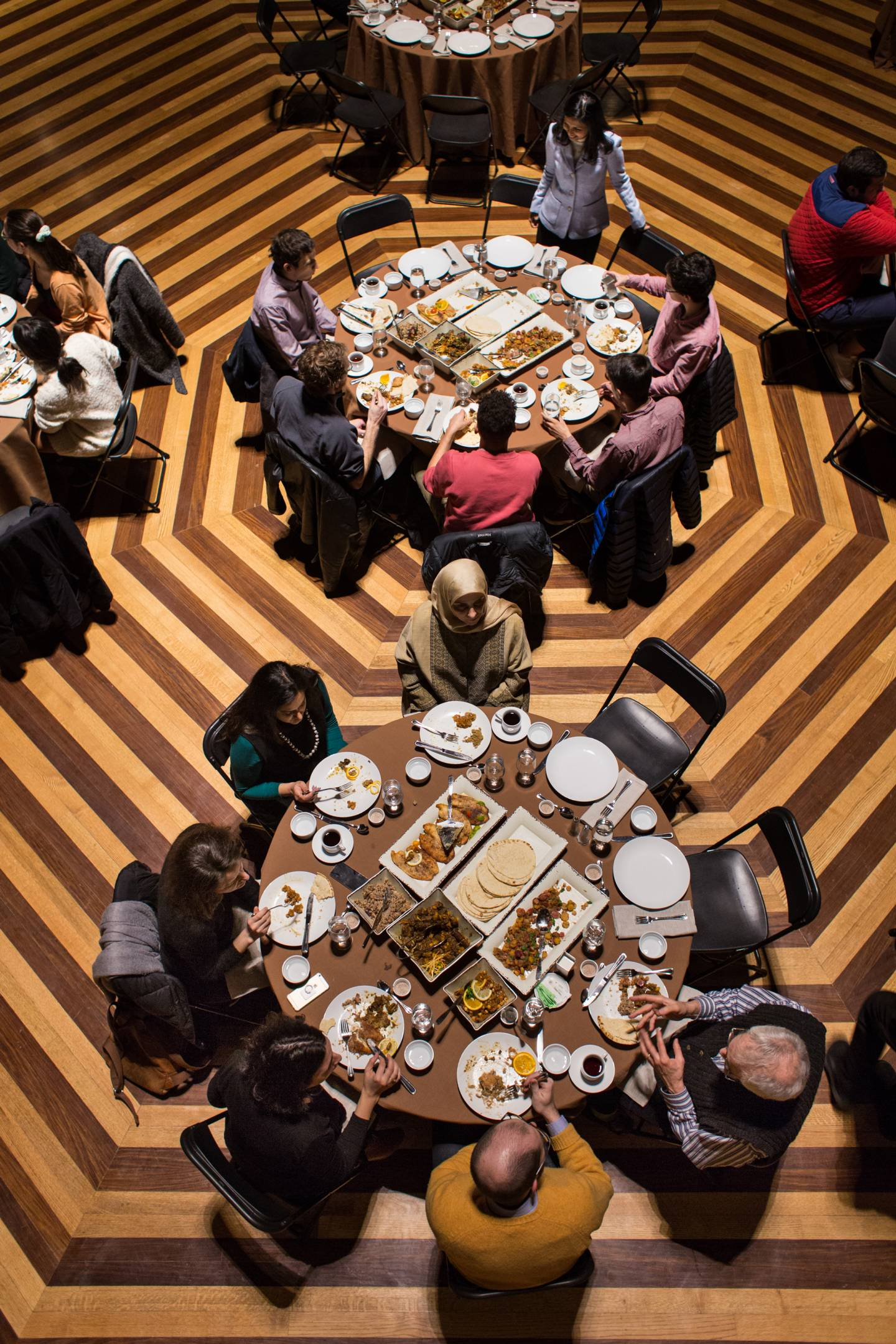 Students sit at tables during Medieval Cairo banquet