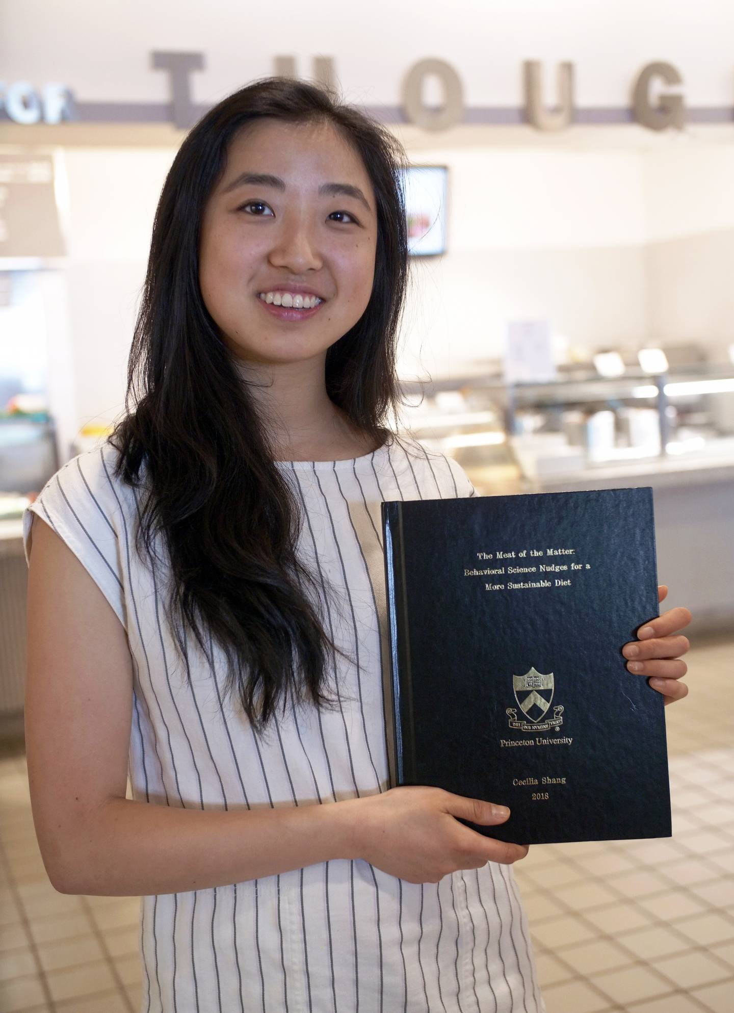 Cecilia Shang with her thesis