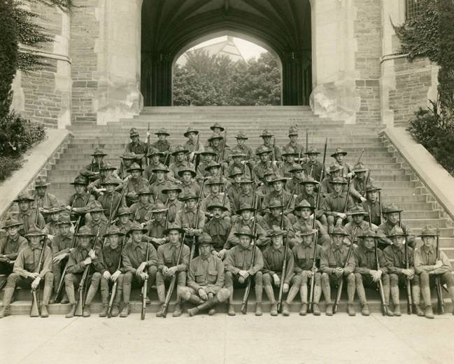 Students in military uniform pose under Blair Arch circa 1915