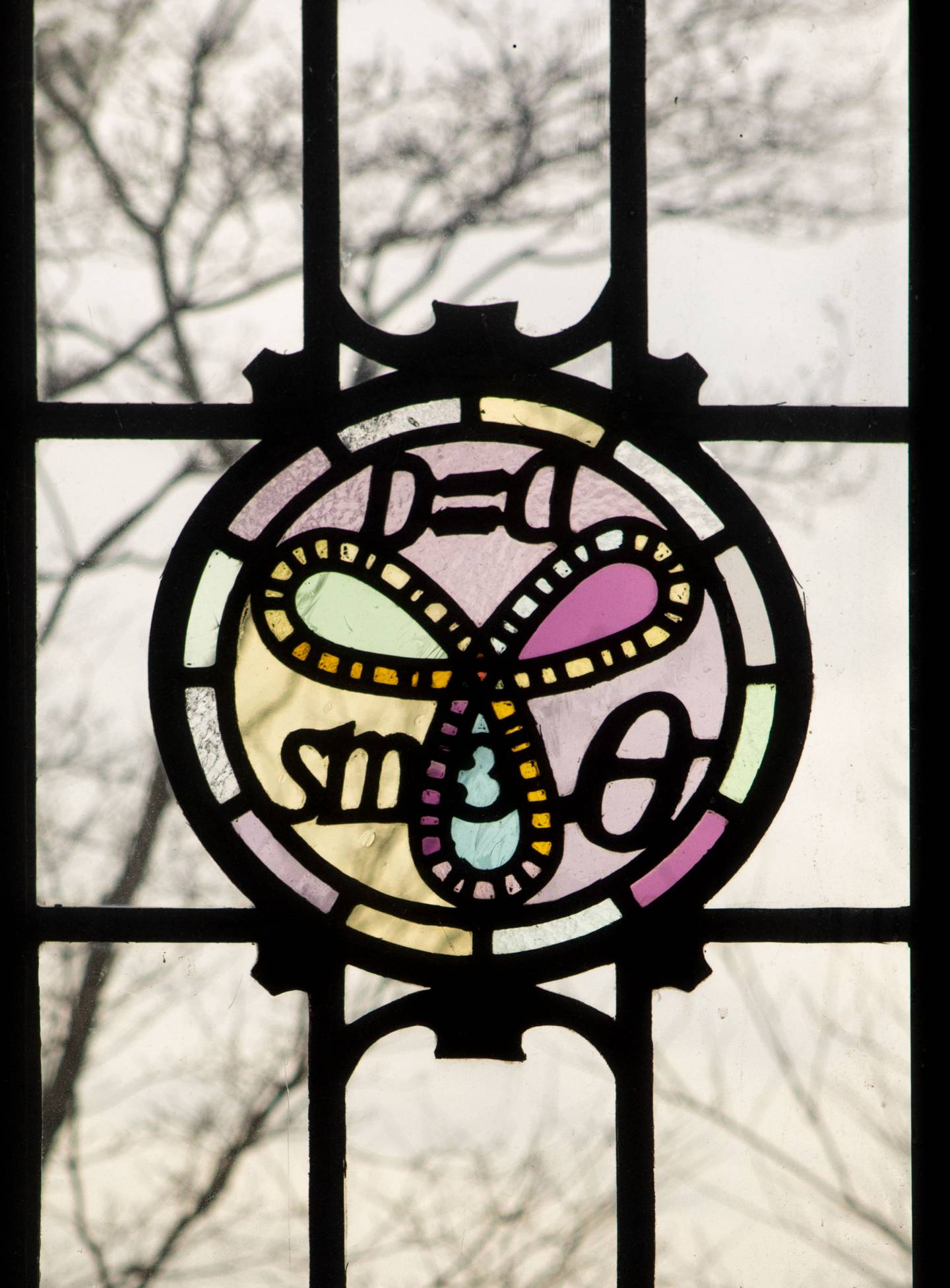 Fine Hall window with math formula in stained glass