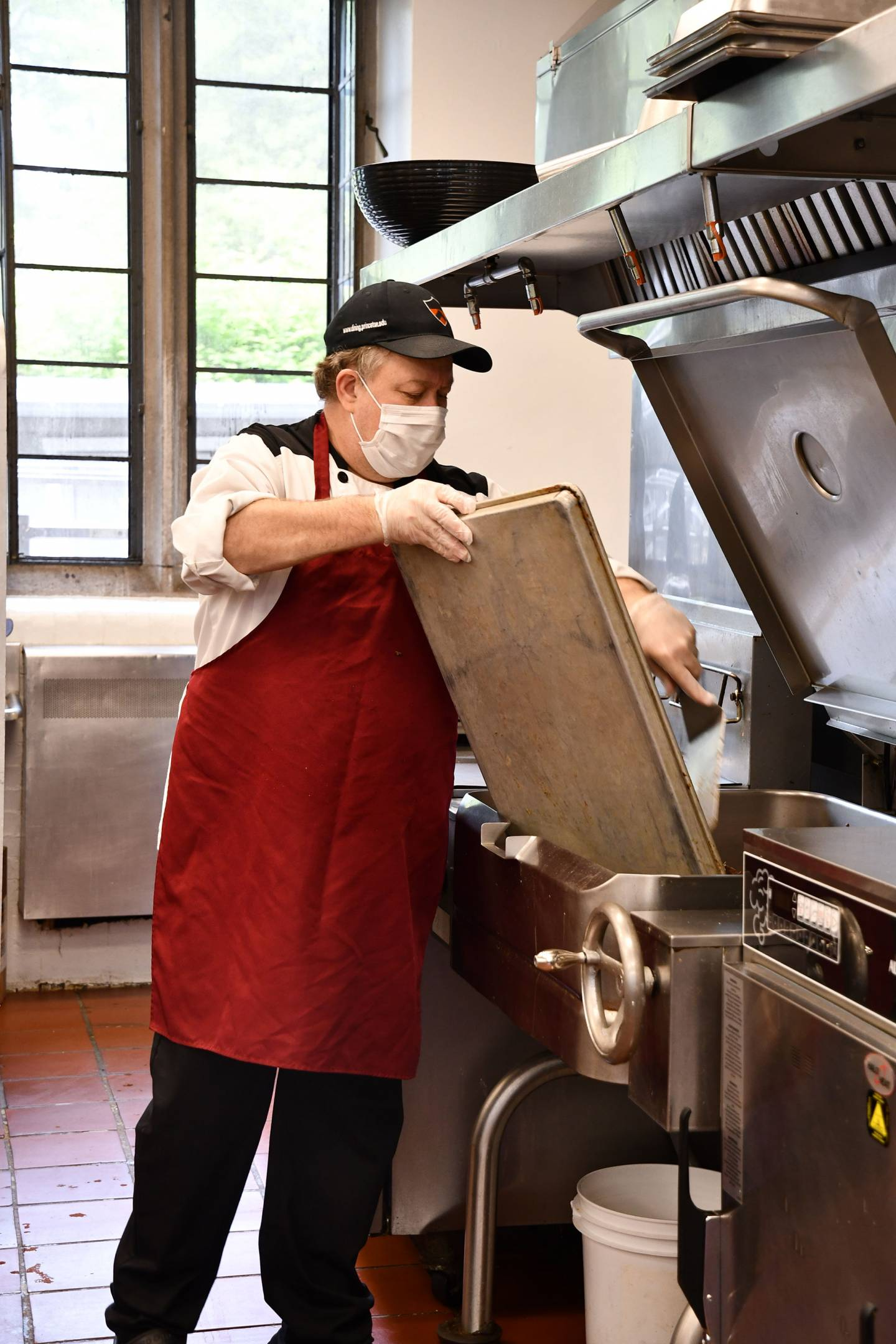 A campus Dining employee handles a sheet pan