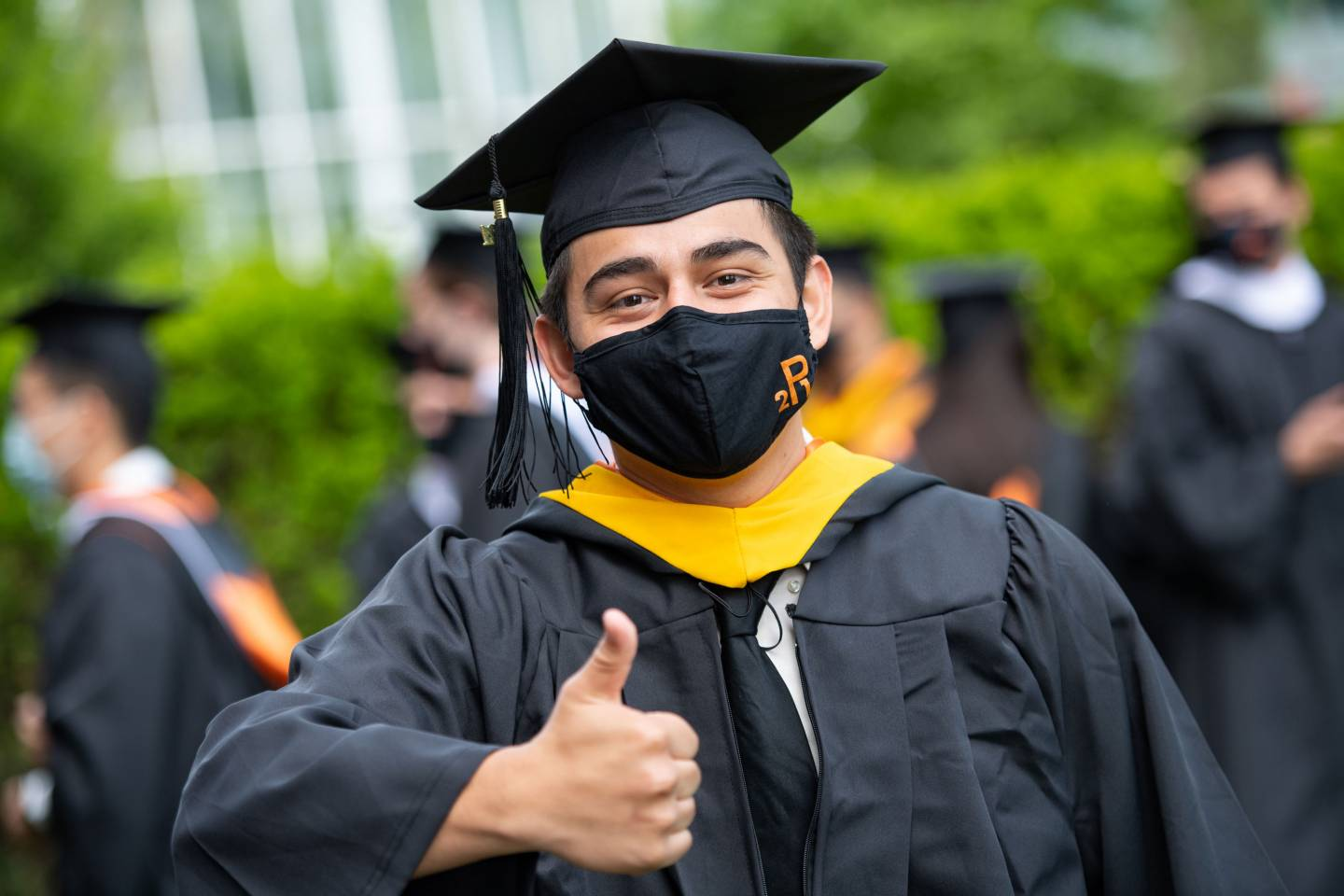 A student gives a thumbs up sign