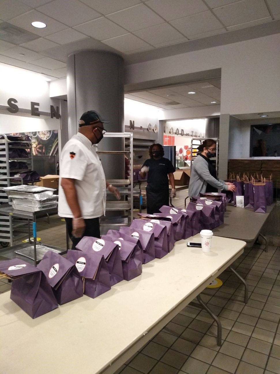 Campus Dining workers line up packages of food to be delivered