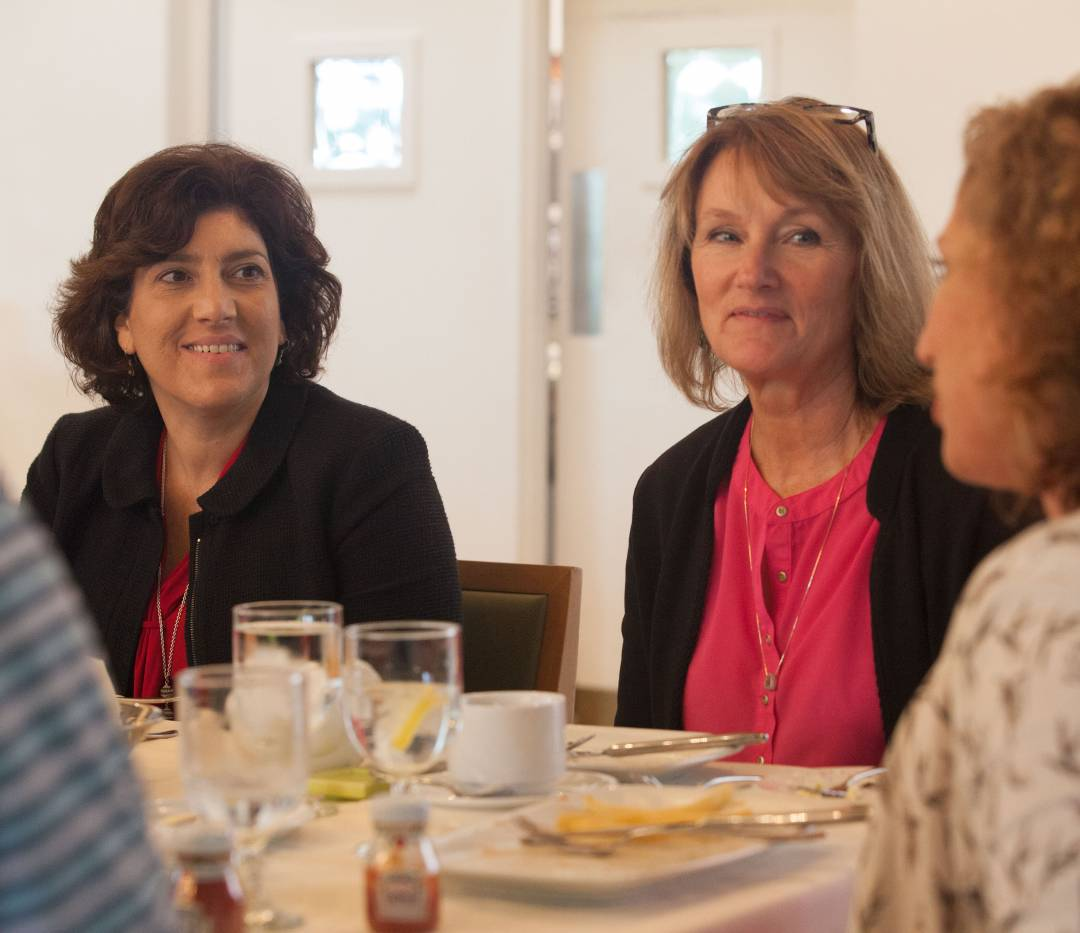Participants in Princeton's Community College Faculty Program sit at a meal together