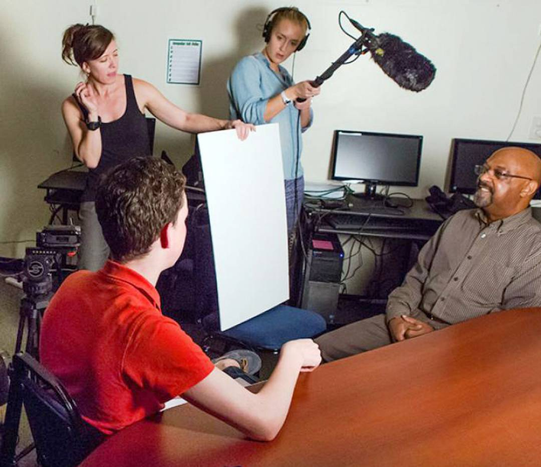 Student team producing a video interview a subject