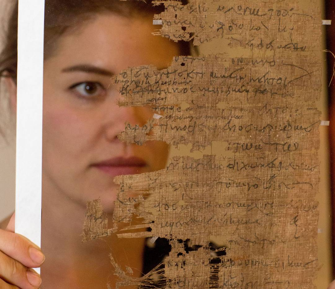 Graduate Student Katherine PD Huemoeller studying papyrus