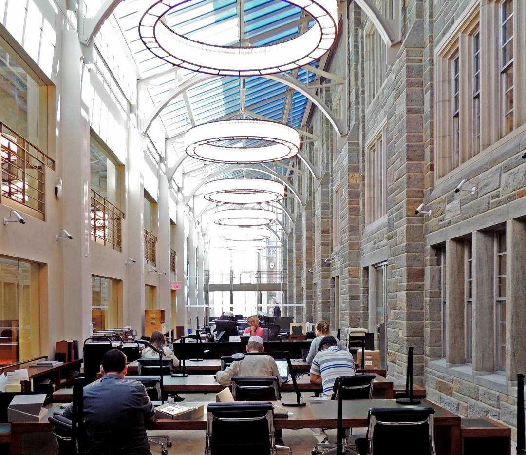 Students studying in Firestone Library atrium