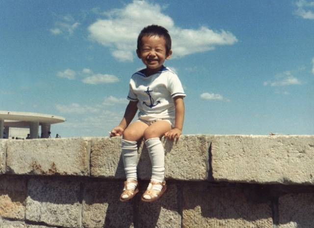 Xiyue Wang as a boy in China