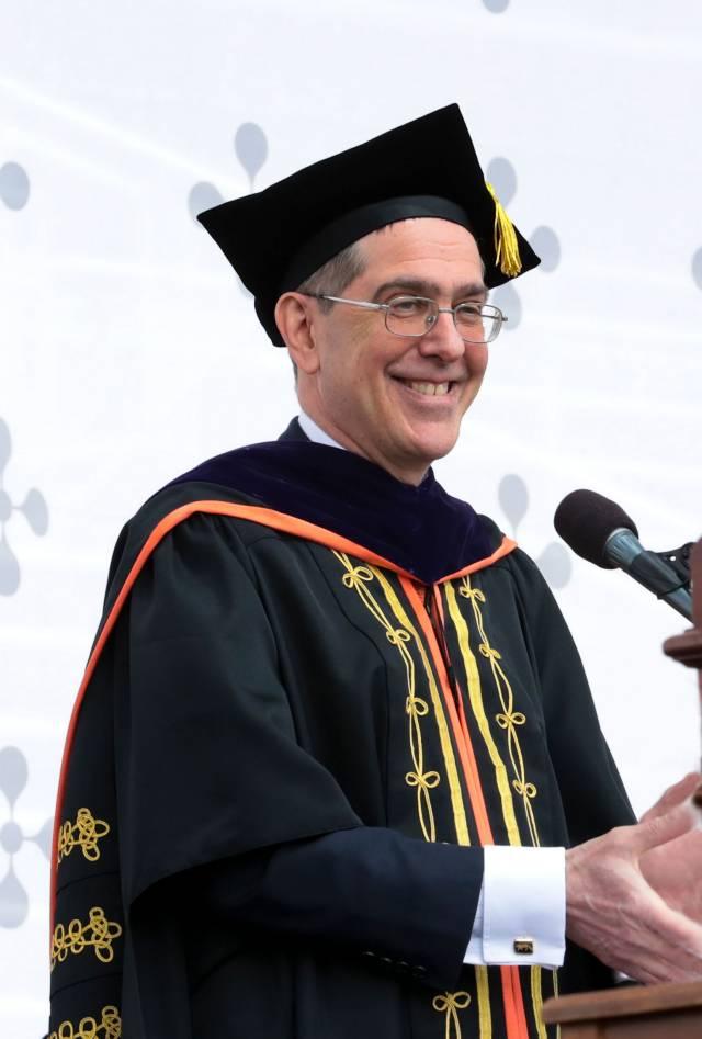 President Christopher L. Eisgruber applauds